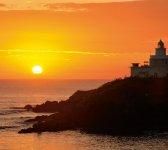 日の出:納沙布岬灯台と日の出