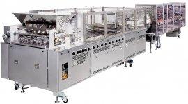 全自動どら焼機は、生地搾り・焼く・餡を搾る・挟むといった生産工程の全てを自動で行う