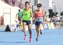ドバイ2019世界パラ陸上競技選手権大会で星野和昭ガイド(左)と力走する唐澤剣也選手 撮影:吉村もと