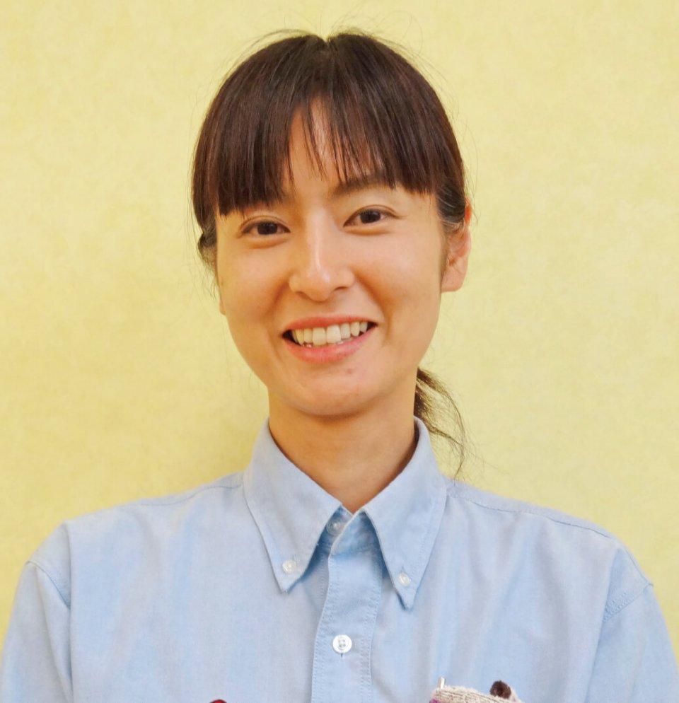 派遣スタッフから正社員雇用となった森田理恵さん。留学経験と女性ならではの感性を発揮し、広報スタッフとして活躍している