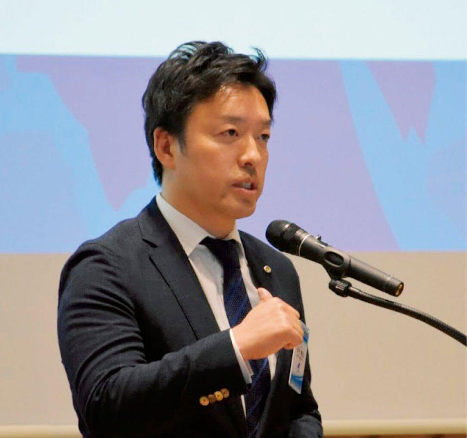 あいさつする日本YEG・田中暢之会長