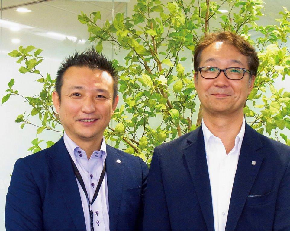 高橋選手の採用に直接関わった櫻井景さん(左)と、人事部部長の貞苅毅さん