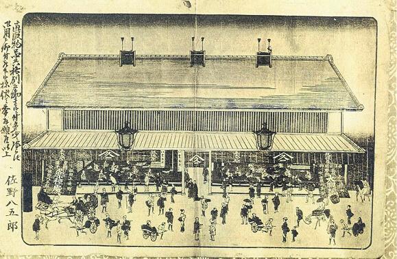 江戸時代ごろの店舗を描いた絵。店の左が薬屋、右が呉服屋になっている