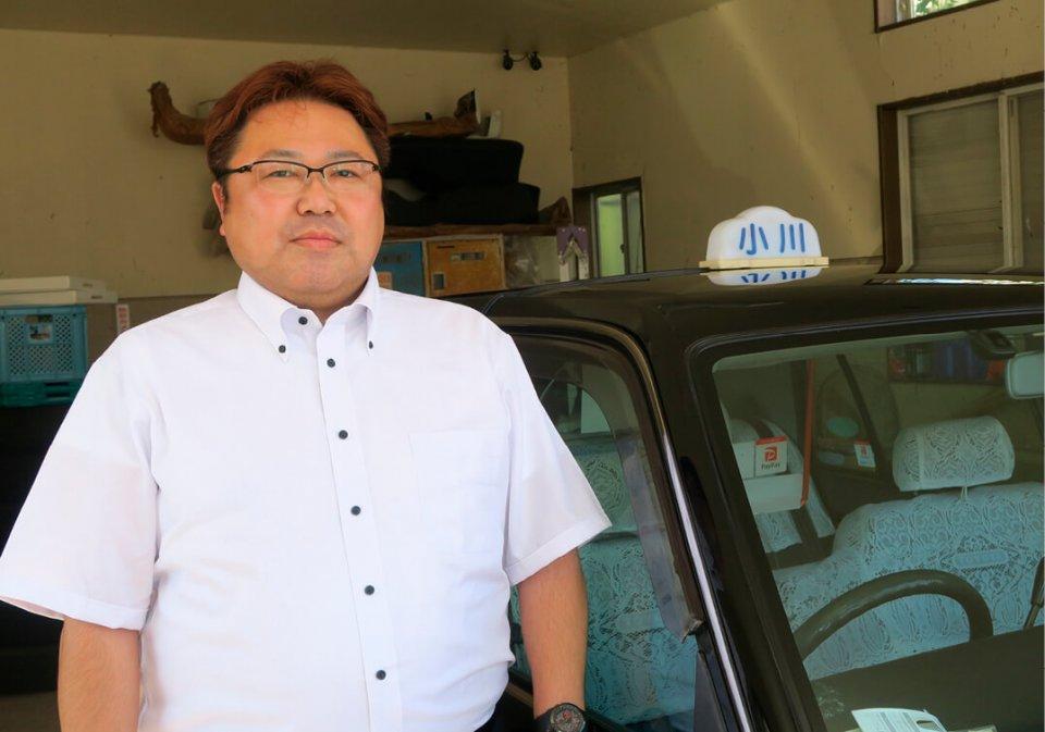 小川タクシー社長の小川喜晴さん。「便利タクシーで、お客さまも飲食店も、そしてうちも、みんなハッピーになれたらと思っています」