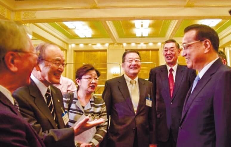 会談する李首相(右)と三村会頭(左から2人目)